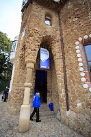The intricately designed entrance buildings beside the main gate in Park Guell, Barcelona, Spain.