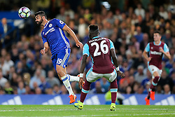 Diego Costa of Chelsea is challenged by Arthur Masuaku of West Ham United - Rogan Thomson/JMP - 15/08/2016 - FOOTBALL - Stamford Bridge Stadium - London, England - Chelsea v West Ham United - Premier League Opening Weekend.