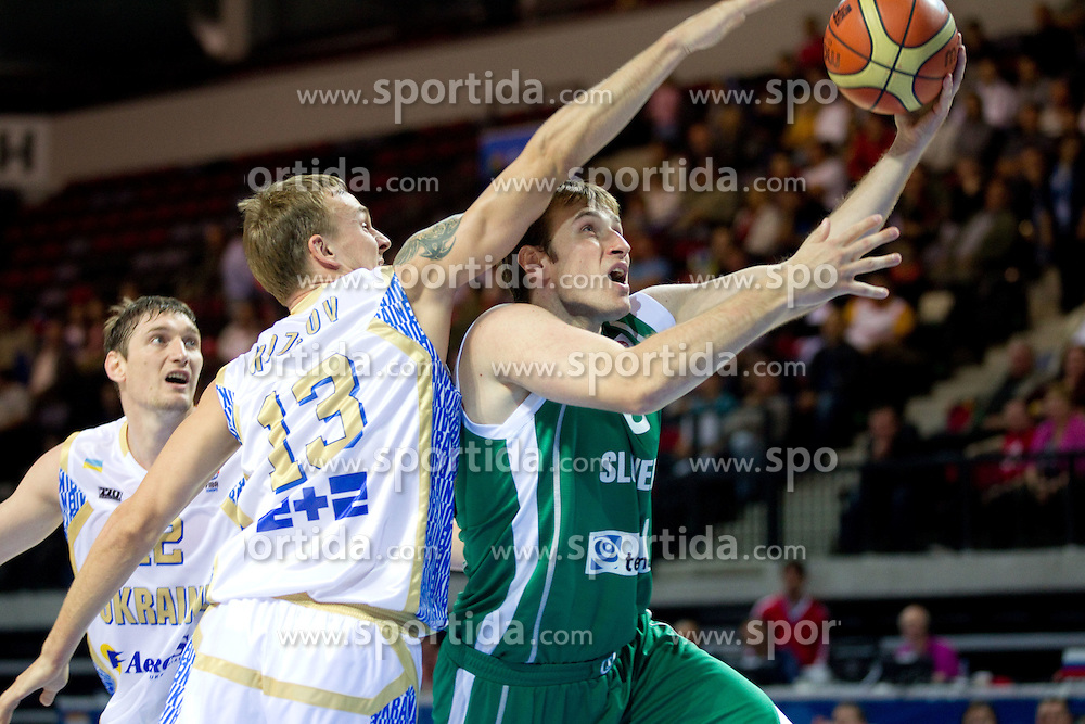 Danylo Kozlov of Ukraine vs Matjaz Smodis of Slovenia during basketball match between National teams of Ukraine and Slovenia in Group D of Preliminary Round of Eurobasket Lithuania 2011, on September 1, 2011, in Arena Svyturio, Klaipeda, Lithuania. Slovenia defeated Ukraine 68 - 64. (Photo by Vid Ponikvar / Sportida)