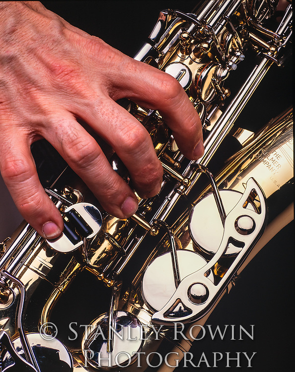 Hands on a Saxophone detail
