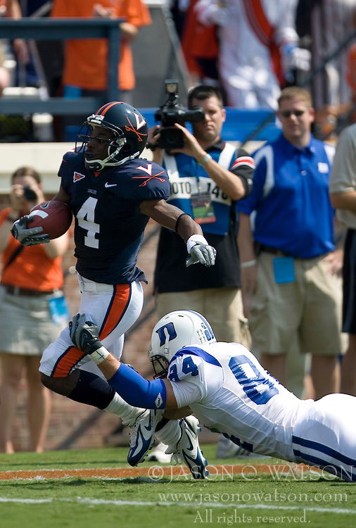 Virginia cornerback Vic Hall (4) is tackeled by Duke defensive end Patrick Bailey (84) at the end of a 67 yard punt return.  The Virginia Cavaliers defeated the Duke Blue Devils 23-14 at Scott Stadium in Charlottesville, VA on September 8, 2007  With the loss, Duke extended their longest-in-the-nation losing streak to 22 games.