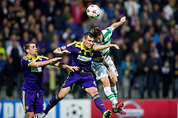 Soares Bordignon Arghus of Maribor vs Adrien Silva of Sporting during football match between NK Maribor and Sporting Lisbon (POR) in Group G of Group Stage of UEFA Champions League 2014/15, on September 17, 2014 in Stadium Ljudski vrt, Maribor, Slovenia. Photo by Vid Ponikvar  / Sportida.com