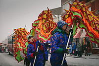 St. Therese Chinese Catholic School seventh graders Wyatt Harley and Victor Ruanb bring up the belly of a dragon during the Lunar New Year Parade in Chicago's Chinatown. |||| Rites of Passage define our lives. They signify the progress of time as well as our citizenship in a tribe, in a culture — in life itself. Chicago commemorates these moments in ways that reflect its diversity, but through difference, we find commonality. We are all connected through these formal and informal ceremonies that remind us how much family, love and time shape us.