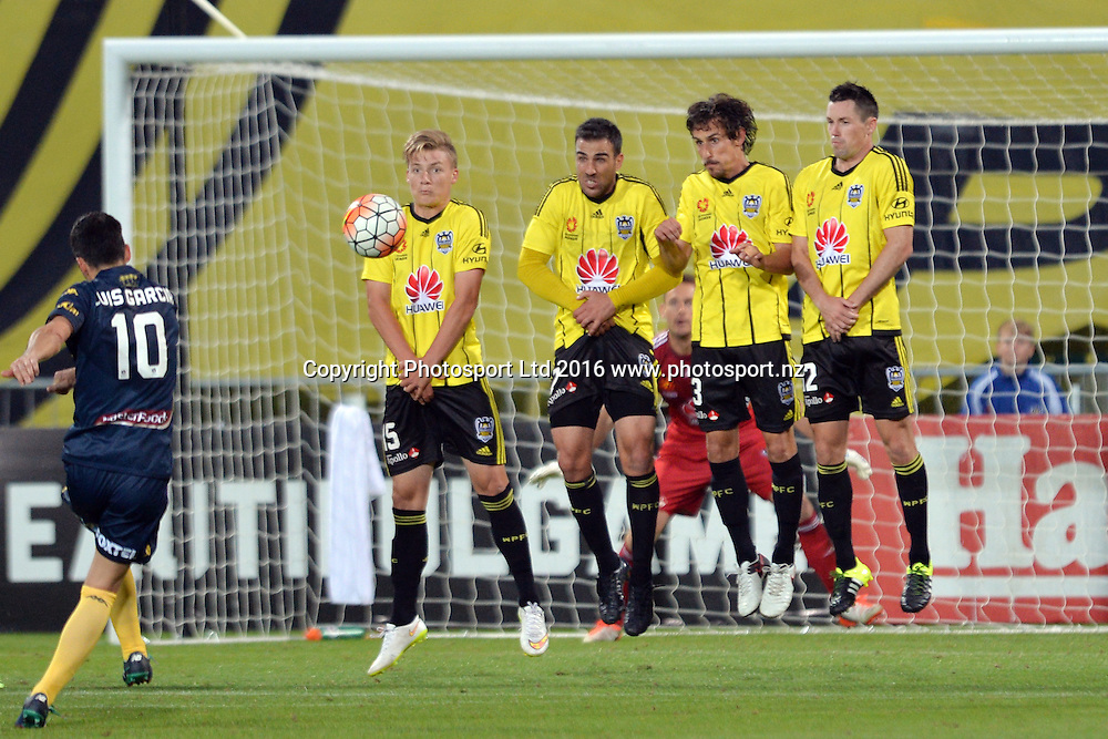 Luis Garcia of the Mariners shooting a free-kick and James McGarry, Manny Muscat, Albert Riera Vidal and Blake Powell of the Phoenix (L-R) reacting during the round 17 A-League match between the Wellington Phoenix and the Central Coast Mariners at AMI Stadium in Christchurch, New Zealand. 30 January 2016. Photo: Kai Schwoerer / www.photosport.nz