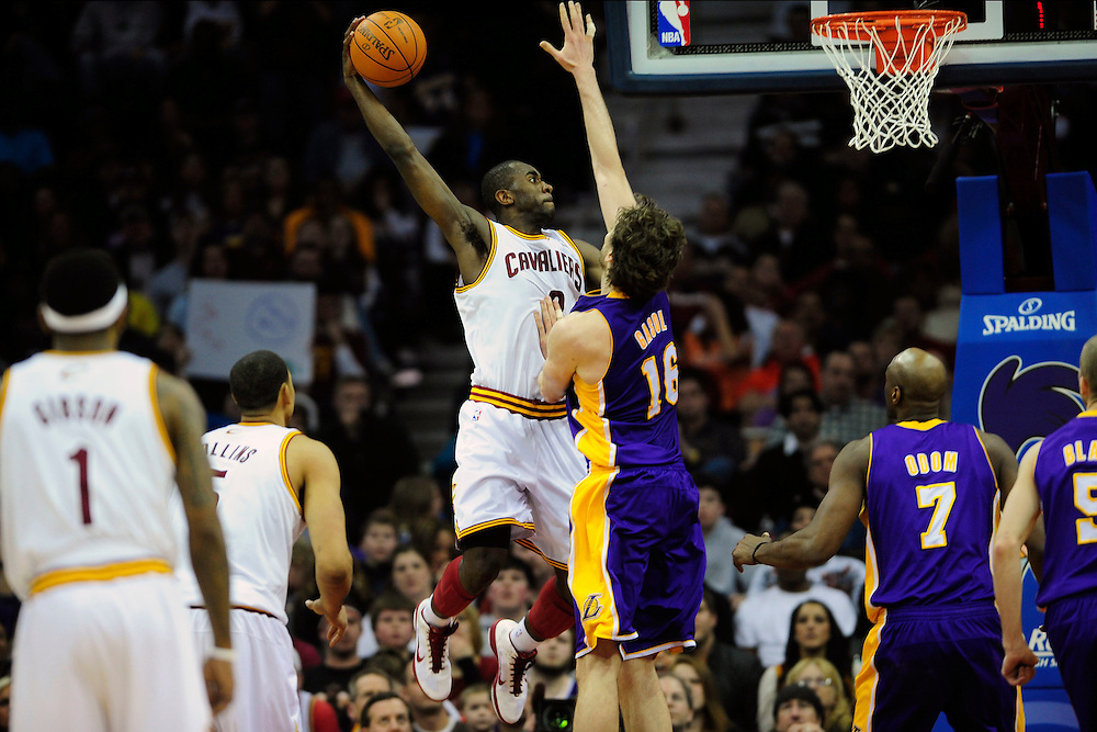 Feb. 16, 2011; Cleveland, OH, USA; Cleveland Cavaliers guard Christian Eyenga (8) soars in for a dunk over Los Angeles Lakers power forward Pau Gasol (16) during the fourth quarter at Quicken Loans Arena. The Cavaliers beat the Lakers 104-99. Mandatory Credit: Jason Miller-US PRESSWIRE