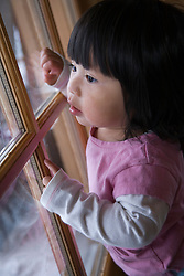 North America, United States, Washington, Crystal Mountain, girl (age 2) looking out of window  MR