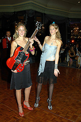 Leeft to right, sisters LARA BOGLIONE and ANNA BOGLIONE at the Chain of Hope Autumn Ball Fiesta held at The Dorchester, Park Lane, London on 6th October 2004.
