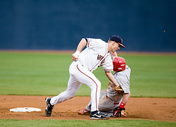 Virginia Cavaliers INF David Adams (23) tags Radford Highlanders LF Will Naylor (11) who tried to steal second.  The #16 ranked Virginia Cavaliers baseball team defeated the Radford Highlanders 8-2 at the University of Virginia's Davenport Field in Charlottesville, VA on March 11, 2008.