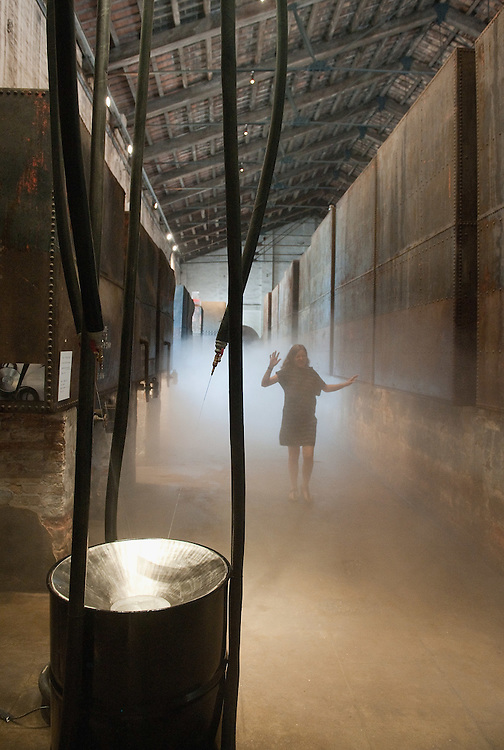 "VENICE, ITALY - JUNE 04: A woman walks  towards the installation ""I Plead: Rain"" by Liang Yuanwei inside the Chinese Pavillion on June 4, 2011 in Venice, Italy. This year's Biennale is the 54th edition and will run from June 4th until November 27."