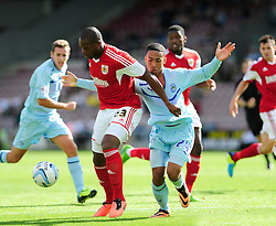 Bristol City's Marlon Harewood holds up the ball from Coventry City's Jordan Clarke - Photo mandatory by-line: Dougie Allward/JMP - Tel: Mobile: 07966 386802 11/08/2013 - SPORT - FOOTBALL - Sixfields Stadium - Sixfields Stadium -  Coventry V Bristol City - Sky Bet League One