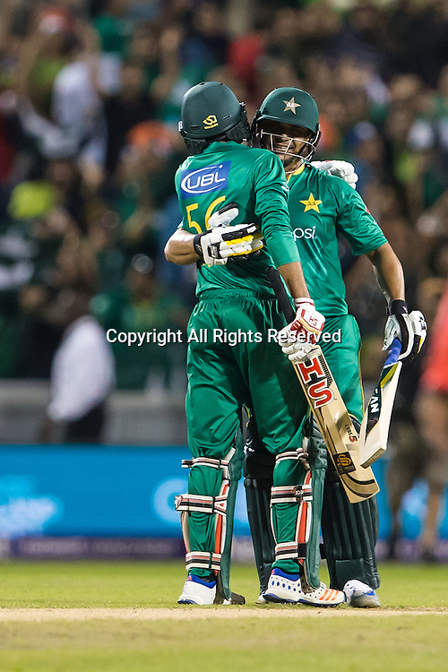 07.09.2016. Old Trafford, Manchester, England. Natwest International T20 Cricket. England Versus Pakistan. Pakistan batsman Babar Azam  and Pakistan all rounder Shoaib Malik celebrate their  victory.