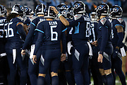 The Tennessee Titans huddle before the week 14 regular season NFL football game against the Jacksonville Jaguars on Thursday, Dec. 6, 2018 in Nashville, Tenn. The Titans won the game 30-9. (©Paul Anthony Spinelli)