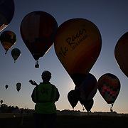 A competition judge checks marker positions as Hot Air balloonist drop markers at a goal location around rural Michigan near Battle Creek during the World Hot Air Ballooning Championships. Battle Creek, Michigan, USA. 21st August 2012. Photo Tim Clayton