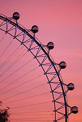 © licensed to London News Pictures. London, UK 05/12/2013. Sunrise over the London Eye on Thursday, 5 December 2013. Photo credit: Tolga Akmen/LNP