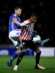 Birmingham City's Lukas Jutkiewicz, (left) battles for possession of the ball with Brentford's Ezri Konsa