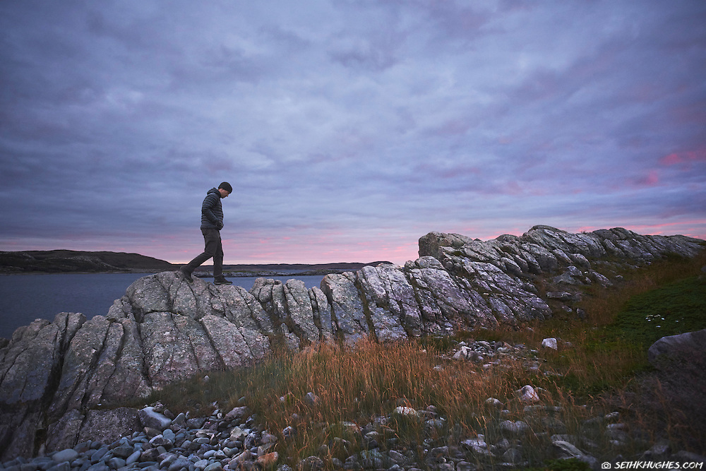 Exploring the rocky coastline of Fogo Island, Newfoundland, Canada