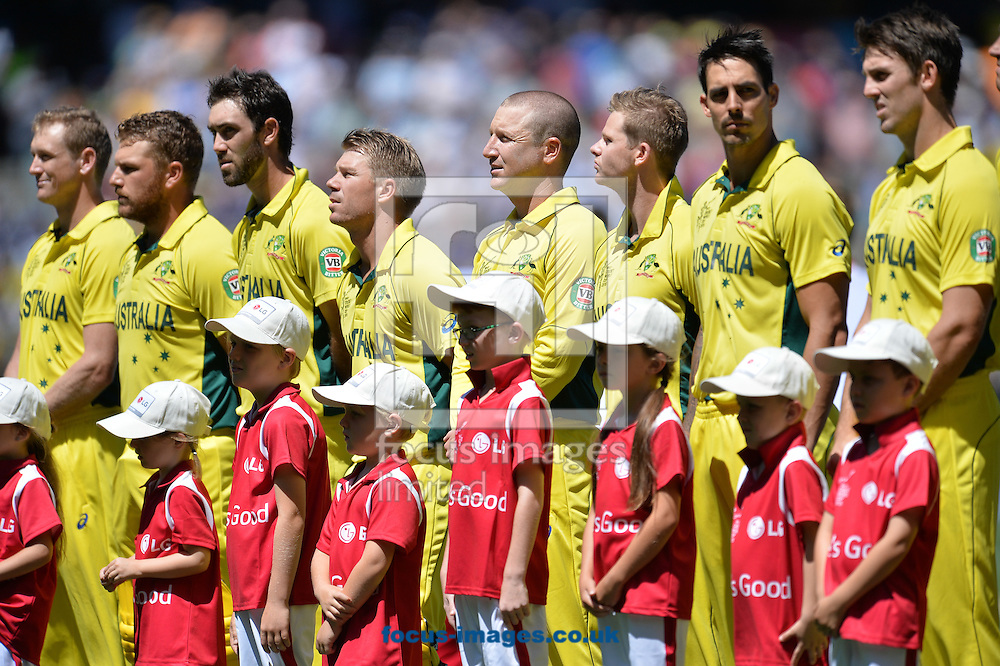 The players of Australia stand for the national anthem during the 2015 ICC Cricket World Cup match at Melbourne Cricket Ground, Melbourne<br /> Picture by Frank Khamees/Focus Images Ltd +61 431 119 134<br /> 14/02/2015