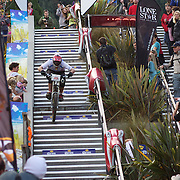Reon Boe from Queenstwown heads down the Brecon Street steps in Queenstown to win the Corona Dirtmasters Downhill event in Queenstown, Central Otago. Eighty competitors tackled the technically demanding course which started at the Gondola summit and finished with a run down the steps in Brecon Street, Queenstown. The event was part of the inaugural Queenstown Bike Festival, which took place from 16th-25th April. The event hopes to highlight Queenstown's growing profile as one of the three leading biking centres in the world. Queenstown, Central Otago, New Zealand. 24th April 2011. Photo Tim Clayton..