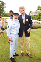 Left to right, SIR JACKIE STEWART and ARNAUD BAMBERGER at a luncheon hosted by Cartier for their sponsorship of the Style et Luxe part of the Goodwood Festival of Speed at Goodwood House, West Sussex on 4th July 2010.
