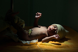 A newborn baby after cesarean section at MSF's Centre de Référence en Urgence Obstétricale (CRUO) in Port-au-Prince, Haiti, October 19, 2015. Baby's mother was admitted due to her high blood pressure.