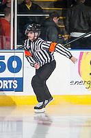 KELOWNA, CANADA - NOVEMBER 22: Referee Mike Langin skates as the Kelowna Rockets play the Portland Winterhawkson November 22, 2014 at Prospera Place in Kelowna, British Columbia, Canada.  (Photo by Marissa Baecker/Shoot the Breeze)  *** Local Caption *** Mike Langin;