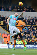 Derby County midfielder Bradley Johnson and Wolverhampton Wanderers defender Jeremy Helan challenge for a header during the Sky Bet Championship match between Wolverhampton Wanderers and Derby County at Molineux, Wolverhampton, England on 27 February 2016. Photo by Alan Franklin.