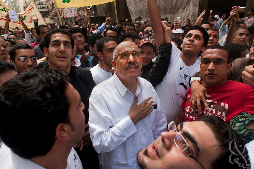 Egyptian Nobel Peace laureate and former UN atomic watchdog chief, Mohamed ElBaradei (C), thanks supporters on balconies above as he leaves Friday noon prayers in the Egyptian delta town of El Mansoura on April 2, 2010. ElBaradei is thought to be a possible candidate to run against Egyptian President Hosni Mubarak in the 2011 presidential election, although he has not made a formal declaration as of yet.