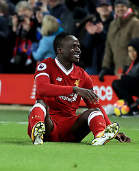 Liverpool's Sadio Mane sits on the pitch to celebrate scoring his side's third goal during the Premier League match at Anfield, Liverpool.