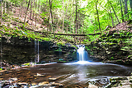 Wide angle view of Cottonwood Falls along the Double Run Trails at Worlds End State Park in Pennsylvania.