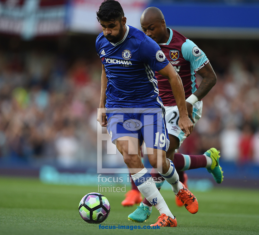 Chelsea's Diego Costa of Chelsea and West Ham United's Andre Ayew of West Ham United during the Premier League match at Stamford Bridge, London<br /> Picture by Daniel Hambury/Focus Images Ltd +44 7813 022858<br /> 15/08/2016