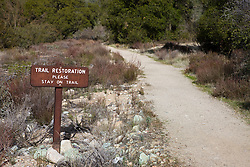 "Sign along the Old Pinnacles Trail that reads ""Trail Restoration Please Stay on Trail"", Pinnacles National Monument, California, United States of America"