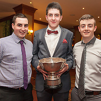 James Keane, Dylan McGerr and Joesph Galligher, members of the Inagh/Kilnamona Junior A winning team receiving their medals on the night