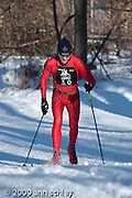 Classic skiers just after crossing Glenwood in the City of Lakes Loppet.