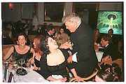 Monica Lewinsky; Tony Curtis. Vanity Fair Oscar night party. Mortons. Los Angeles. 28 March 1999. Film 99175f26<br /> © Copyright Photograph by Dafydd Jones 66 Stockwell Park Rd. London SW9 0DA<br /> Tel 0171 733 0108<br /> www.dafjones.com
