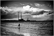 A child runss through the water at Sandymount Strand in Dublin Pic:Marc O'Sullivan