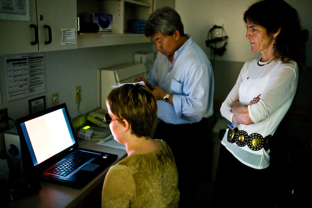 Alisha Bacoccini is tested on her ability to detect color, at UPenn Hospital, in Philadelphia, PA on Monday, June 23, 2008. Bacoccini is undergoing an experimental gene therapy trial to improve her sight.