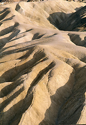 CA: Death Valley National Park Zabriskie Point   .Photo by Lee Foster, lee@fostertravel.com, www.fostertravel.com, (510) 549-2202.Image: cadeat206
