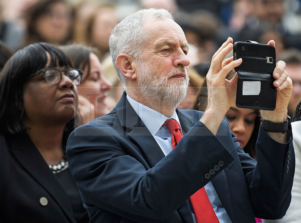 © Licensed to London News Pictures. 24/04/2018. London, UK. Labour Party leader JEREMY CORBYN takes a photograph during the unveiling of a statue of Millicent Fawcett in Parliament Square, London. Dame Millicent, a leading Suffragist and campaigner for equal rights for women, is the first woman to be commemorated with a statue in Parliament Square. Photo credit: Ben Cawthra/LNP