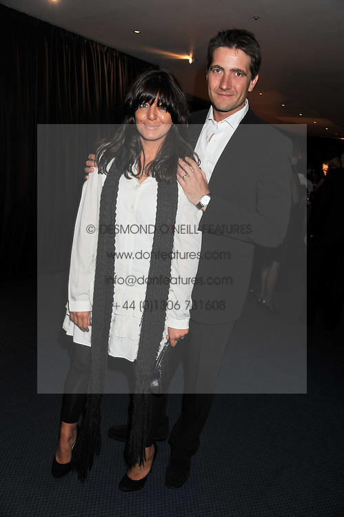 CLAUDIA WINKLEMAN and KRIS THYKIER at the GQ Men of the Year 2011 Awards dinner held at The Royal Opera House, Covent Garden, London on 6th September 2011.