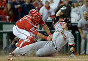 Oct 4, 2014; Washington, DC, USA; Washington Nationals catcher Wilson Ramos (40) tags out San Francisco Giants catcher Buster Posey (28) at the plate in the ninth inning of game two of the 2014 NLDS playoff baseball game at Nationals Park. Mandatory Credit: H. Darr Beiser-USA TODAY Sports ORG XMIT: USATSI-189978 ORIG FILE ID:  20141004_ajw_usa_345.JPG