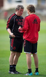 LIVERPOOL, ENGLAND - Wednesday, August 18, 2010: Liverpool's manager Roy Hodgson has a quiet word with Lucas Leiva during a training session at Melwood ahead of the UEFA Europa League Play-Off 1st Leg match against Trabzonspor A.S. (Pic by: David Rawcliffe/Propaganda)