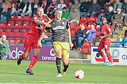 York City midfielder Russell Penn closes down Cambridge United forward Liam Hughes  during the Sky Bet League 2 match between York City and Cambridge United at Bootham Crescent, York, England on 3 October 2015. Photo by Simon Davies.
