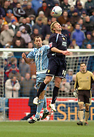 Photo: Leigh Quinnell.<br /> Coventry City v Leeds United. Coca Cola Championship. 18/03/2006. Leeds' Rob Hulse leaps above Coventrys Don Hutchison.