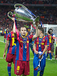 28.05.2011, Wembley Stadium, London, ENG, UEFA CHAMPIONSLEAGUE FINALE 2011, FC Barcelona (ESP) vs Manchester United (ENG), im Bild FC Barcelona's Andres Iniesta celebrates with the European Cup trophy after thrashing Manchester United 3-1 during the UEFA Champions League Final at Wembley Stadium, EXPA Pictures © 2011, PhotoCredit: EXPA/ Propaganda/ Chris Brunskill *** ATTENTION *** UK OUT!