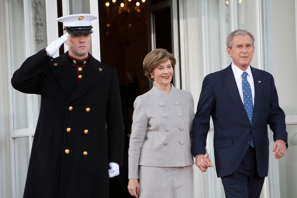 WASHINGTON - JANUARY 20: President George W. Bush and First Lady Laura Bush walk out of the White House to greet President-elect Barack Obama and Michelle Obama  before the two families have coffee together on January 20, 2009 in Washington, DC. President-elect Barack Obama will be sworn in as the country's 44th president at noon today. (Photo by Brendan Hoffman/Getty Images) *** George W. Bush;Laura Bush