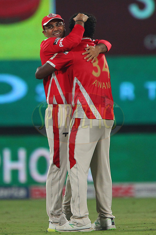 Virender SEHWAG of the Kings XI Punjab congratulates Parvinder AWANA  of the Kings XI Punjab  on the wicket of M S DHONI (Captain) of the Chennai Superkings  during the second semi final match of the Oppo Champions League Twenty20 between the Kings XI Punjab and the Chennai Superkings held at the Rajiv Gandhi Cricket Stadium, Hyderabad, India on the 2nd October 2014<br /> <br /> Photo by:  Ron Gaunt / Sportzpics/ CLT20<br /> <br /> <br /> Image use is subject to the terms and conditions as laid out by the BCCI/ CLT20.  The terms and conditions can be downloaded here:<br /> <br /> http://sportzpics.photoshelter.com/gallery/CLT20-Image-Terms-and-Conditions-2014/G0000IfNJn535VPU/C0000QhhKadWcjYs