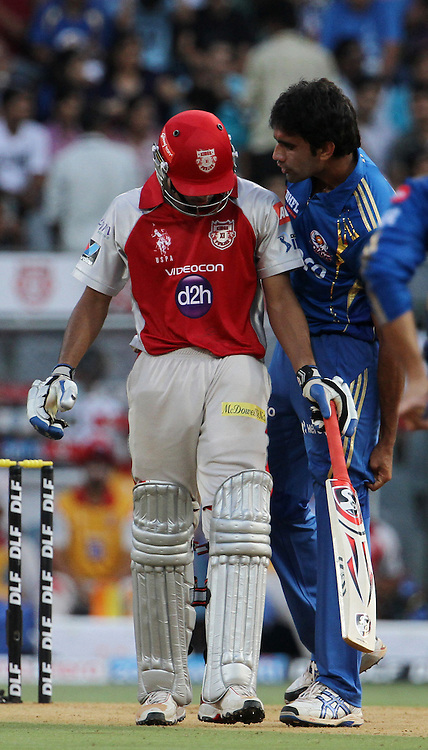 Mumbai Indian player Munaf Patel argues with Kings XI Punjab player Nitin Saini during match 28 of the Indian Premier League ( IPL) 2012  between The Mumbai Indians and the Kings X1 Punjab held at the Wankhede Stadium in Mumbai on the 22nd April 2012..Photo by: Vipin Pawar/IPL/SPORTZPICS