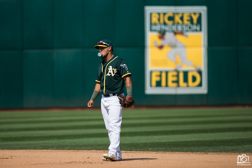 Oakland Athletics second baseman Franklin Barreto (1) blows a bubble at second base during a MLB game against the Los Angeles Angels at Oakland Coliseum in Oakland, California, on September 6, 2017. (Stan Olszewski/Special to S.F. Examiner)