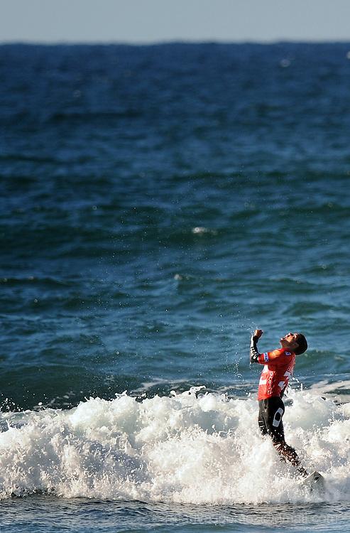 Brazilian surfer Adriano de Souza, Mineirinho, celebrates as he takes part in the Billabong Pro Mundaka 2009, in the northern Spanish Basque village of Sopelana, on October 13, 2009. Photo Rafa Rivas