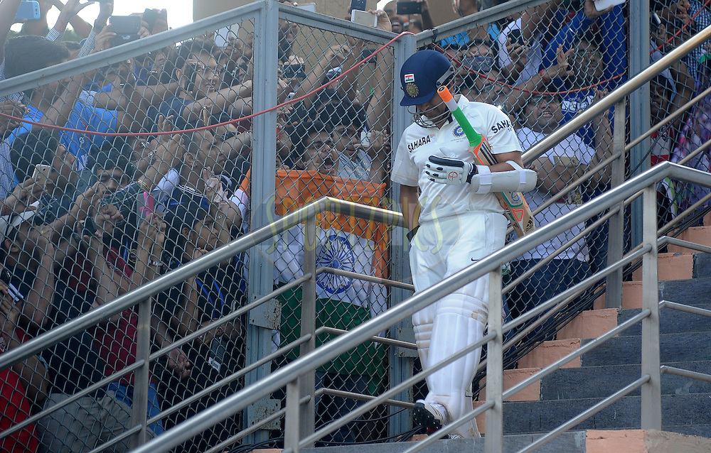 crowd cheer as Sachin Tendulkar of India walks out to bat during day two of the second Star Sports test match between India and The West Indies held at The Wankhede Stadium in Mumbai, India on the 15th November 2013<br /> <br /> This test match is the 200th test match for Sachin Tendulkar and his last for India.  After a career spanning more than 24yrs Sachin is retiring from cricket and this test match is his last appearance on the field of play.<br /> <br /> <br /> Photo by: Pal PIllai - BCCI - SPORTZPICS<br /> <br /> Use of this image is subject to the terms and conditions as outlined by the BCCI. These terms can be found by following this link:<br /> <br /> http://sportzpics.photoshelter.com/gallery/BCCI-Image-Terms/G0000ahUVIIEBQ84/C0000whs75.ajndY